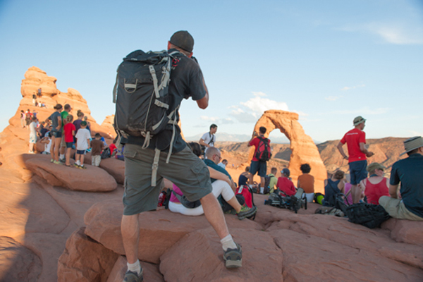 Patrick Cobb, quick on his feet and shooting from unique vantage points at Delicate Arch, Arches National Park. © Ryan Hetzel