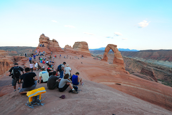 The crowds gather for sunset at Delicate Arch, Arches National Park. © Ryan Hetzel
