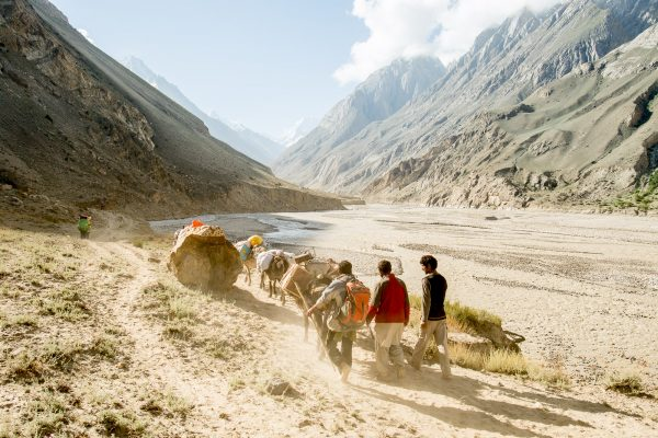 """Here we are, in the Karakoram, Pakistan! After two days in airplanes, one day at the hotel and one day in the jeep we were looking forward to six long days trek to base camp! Together with the sherpas, hundreds of porters, donkeys and some other climbers we were definitely on the go!"""